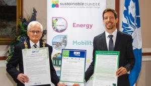Triple climate pledges signed Image